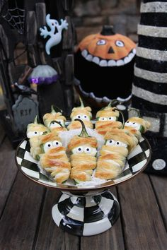 Add some spice to your Halloween buffet table with Jalapeño Popper Mummies.