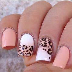 Peach and white nails with leopard nail art