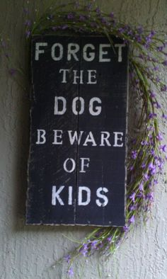 """Forget the dog, beware of kids"" sign"