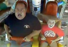 Scared father rides a rollar coaster with his daughter. Love this picture!