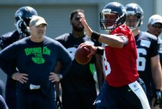 Russell Wilson's second training camp practice comes with a catch