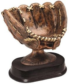 softball glove trophy holds softball with players signatures.