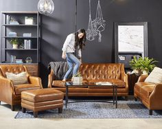 """They got a shot of me in the showroom yesterday """"distressing"""" the leather sofa that's available in my Spring line. I'm loving leather these days and the leather on this collection looks better with the natural wear and tear that happens over the years- this is a good option if you have kids! #character #magnoliahome @highpointmarket"""