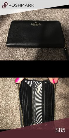 Like New Kate Spade Zip continental Wallet Like New.  No stains or scratches.  Black leather.  Only selling, no trades. kate spade Bags Wallets