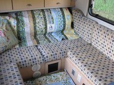 Here's a look at the camping quilt a friend made for my trailer. Most trailer upholstery is gawd-awful, mine is pretty awesome considering what else is out there. Gets busy with the quilt, but the quilt is covering the bedroll and linens :)