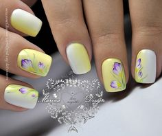 Ombre White and Yellow Floral Nail Art Design. If you want something floral on your nails, try this one out. The ombre look and the purple flowers over the ombred nails are just awesome.