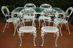 A Chantilly Rose 7pc Dining Set by Woodard, Mid 20thC, 2 armchairs & 4 sides with matching table / Joan Bogart