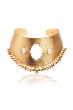 A gold choker instantly adds a dose of confidence to an outfit. Shop the 11 best statement pieces on the market, including this Paula Mendoza Jarma Cuff Necklace, here.