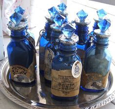 """Check out our new Romantic Cowgirl Altered Art Bottles - """"TOMBSTONE TONIC"""".  They were loads of fun  to create.  $19.50 each.  Made with vintage bottles and handmade labels, tags and crystal-like tops!  Ready to fill with your favorite potion.  Lots more Cowgirl Glam and Gypsy Chic at www.RedRockRoseBoutique.blogspot.com"""