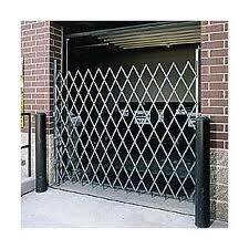 Door gates pivot on hinges, so they open in or out, just like a door, but also provide the enhanced air circulation and visibility of a standard steel folding gate.  Folding door gates offer better circulation and added light that helps save money on energy costs.  Increased security reduces theft and loss prevention costs.  Healthier work environment, safer schools and a secure warehouse or business.  No matter what your situation is, we have a solution and will custom build you a door gate…