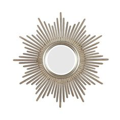 With sunburst mirrors staying in the spotlight, adding one above the bed or couch creates a focal point in the room.