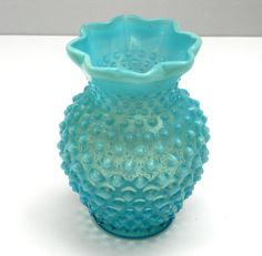"""Beautiful robin's egg blue vase, which I believe was manufactured by Fenton. Fenton first started making hobnail glass in the 1940's. This vase has the eight crimped rim style and is in fantastic condition. The vase measures 5-1/2"""" in height, 3"""" diameter at the top, 2"""" diameter at the base and a circumference of 12.75"""" at it's widest point. Perfect for a gift or to add to an art glass collection!  **************** Please inquire with any questions! As my vintage items have been treasured by…"""