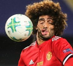 Fellaini catches one right across the face.