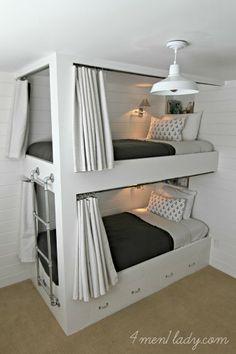 bunk beds, horizontal plank wall, curtains for bunks, lighting