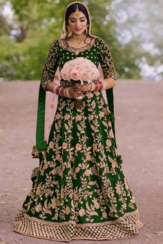 A stylish interpretation of ethnic glamour and contemporary style, this green velvet lehenga which comprises delightful traditional look. This sweetheart neckline and elbow sleeve green blouse embellished in zardosi work. Along with velvet a-line style lehenga in green color with peach net dupatta. A-Line style lehenga has zardosi work. Dupatta adorned with zardosi work. #lehengacholi #lehengadress #Weddingwear #USA #andaazfashion #bridalwear Bridal Lehenga Online, Bridal Lehenga Choli, Silk Lehenga, Rohit Bal, Abaya Fashion, Icon Fashion, Fashion Catalogue, Beautiful Saree, Green Velvet