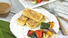 Make this coconut-crusted tofu with spicy peanut sauce for a healthy meatless meal