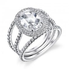 18K white gold Dream ring with an oval rose cut diamond and round brilliant cut colorless diamonds.