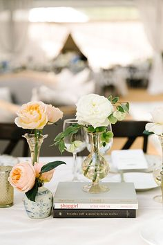 Single Stem Arrangements Stacked on Coffee Table Books | Brides.com
