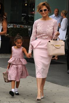 Like mother, like daughter: Jennifer Lopez and her adorable six-year-old daughter Emme got dressed up in similar pale pink peplum outfits as they headed to the League of United Latin American Citizens' (LULAC) 85th National Convention with First Lady Michelle Obama http://dailym.ai/1ncd9hk