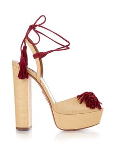 Artisanal detailing is key for SS16, and Aquazzura takes the look to new heights with these beige raffia Wild One sandals. They're crafted in Italy with burgundy suede tassels at the peep-toe front and seasonal wraparound ankle strap, and are elevated with a high platform and block heel. They'll bring statement appeal to pared-back dresses | Available at #MATCHESFASHION