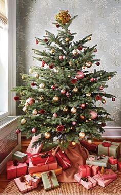 that old-fashioned Christmas tree all decked out with beaded garlands and glass ornaments.