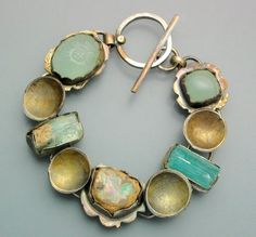 "Temi Kucinski. Aquamarines, Tourmaline and Opal bracelet, 7""."