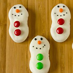 Nutter Butter Snowmen | Brown Eyed Baker - ours did not turn out as fancy/clean cut, but they still looked cute and were easy.