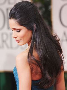 We wish we knew Freida Pinto's secret for such gorgeous, glossy hair!