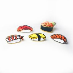 Set of 5 sushi pins- Salmon, Tuna, Ikura, Tamago, and Shrimp (Ebi). 3/4 hard enamel polished silver and gold plated lapel pins with black plastic