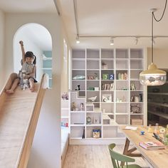 Children can slide down for breakfast and use the swing while studying at this family home.