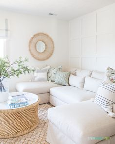 Rustic Home Decor Bright and white den area with large L-shaped Pottery Barn sofa, rattan. mirror, greenery, cane coffee table, and throw pillows. Decor, Living Room Paint, Paint Colors For Living Room, Neutral Decor, Living Room Decor, Pottery Barn Sofa, Cheap Home Decor, Decor Inspiration, Home Decor