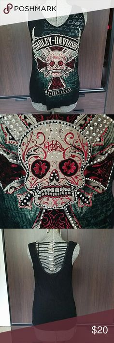 """Harley Davidson Medium Jeweled Skull Tank Top 95% rayon 5% spandex.  Hand wash cold.   Made in USA.  Lots of bling.  See photos for actual condition.  I do not see any damage. Pit to pit approximately 18"""". Harley-Davidson Tops Tank Tops"""