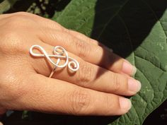 Check out this item in my Etsy shop https://www.etsy.com/listing/109031139/silver-wire-wrapped-clef-music-ring