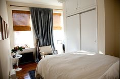 curtains/woven blinds for bedroom window. Great use of awkward space.