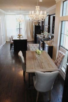 beautiful dining room in open concept kitchen the chandeliers and the wonderful chairs add a nice touch of glam!
