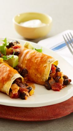 Loaded with black beans, corn and cheese, these meatless enchiladas are easy to…