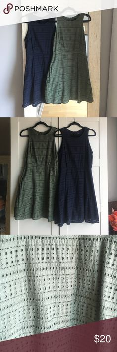 "Two Gap Dresses Two fall Gap dresses. Fully lined with a beautiful laser cut hole pattern. Cinched style waist and flare skirt. Army green and navy blue. Shoulder to hem is 35.5"" long. GAP Dresses Midi"