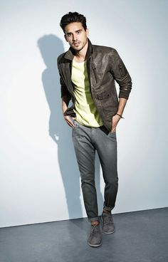 Shop this look for $672:  http://lookastic.com/men/looks/charcoal-bomber-jacket-and-yellow-crew-neck-t-shirt-and-grey-chinos-and-grey-desert-boots/399  — Charcoal Leather Bomber Jacket  — Yellow Crew-neck T-shirt  — Grey Chinos  — Grey Suede Desert Boots