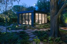 An elegant garden pavilion space - a glass cube framed in dark metal and has all of the essentials. Designed by architect, Shawn Freeman.