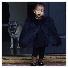 Furry jacket + cat shoes? YAAS. | North West's 24 Best Fashion Moments Of 2014