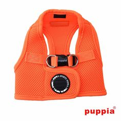 Neon Mesh Soft Dog Harness Vest by Puppia - Orange. Harness your dog's happiness with this comfortable Neon Mesh Soft Dog Harness Vest by Puppia in Orange.Vest-style dog harness with padded mesh for extra comfort and support.Made of high-quality, breathable 100% polyester mesh.Durable metal double d-ring leash attachment.Sporty look, comfortable feel. A dog harness is an essential item for your dog. This nicely designed dog harness provides ultimate support and comfort to your dog. Easy to…