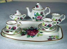Google Image Result for http://cdn100.iofferphoto.com/img3/item/151/258/40/staffordshire-china-minature-tea-set-3a48e.jpg