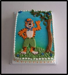 Donation for my Grandson's Cub Scout auction. 9x13 buttercream ,airbrushed back ground with mmf tiger, tree and birds.