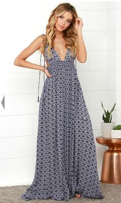 Beautiful Navy and White deep plunging geometric print maxi  dress by En Crème.  Self tie, adjustable shoulder straps.  the elastic waist bodice cascades into an elegant maxi skirt with side slit for a an elegant, but breezy feel.  $59.00.
