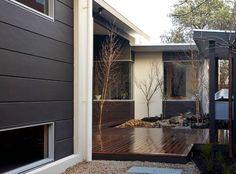 Japanese garden with a combination of Scyon Matrix and Stria painted black. #australianarchitecture #architecture #exteriordesign #exterior #scyonwalls