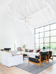 vaulted ceiling in all white living room w steel doors