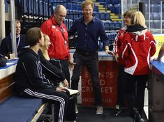 Prince Harry Photos Photos - Prince Harry talks to coaches on a visit to Coach Core at The National Ice Centre on October 26, 2016 in Nottingham, England. The Coach Core apprenticeship scheme was designed by The Royal Foundation of The Duke and Duchess of Cambridge and Prince Harry to take young people aged 16 - 24 with limited opportunities and train them to be sports coaches and positive role models and mentors in their communities. - Prince Harry Visits Nottingham