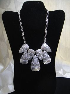 """Silver tribal print necklace that will go with just about any outfit!  10"""" in length"""