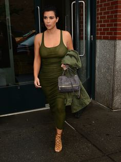 This Is the Reason Kim Kardashian's Outfits Look So Expensive: Armed in all green, Kim's look was streamlined. She added lace-up heels in an understated brown (read: not flashy metallics or a bright color) to complete the look.