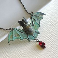 Vampire bat necklace with red tear drop